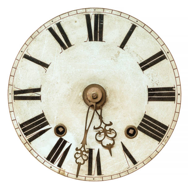 Old clock face with roman numbers stock photo