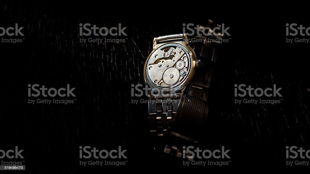 Old clock mechanism on a black background stock photo