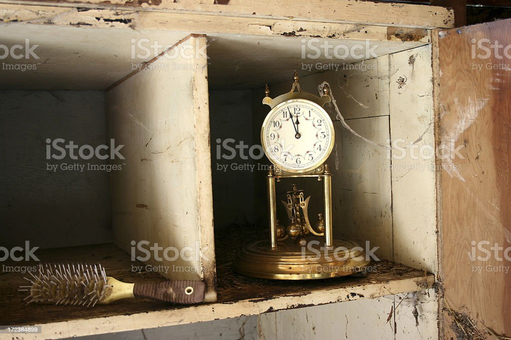 Old clock on shelf with cobwebs - time concept royalty-free stock photo