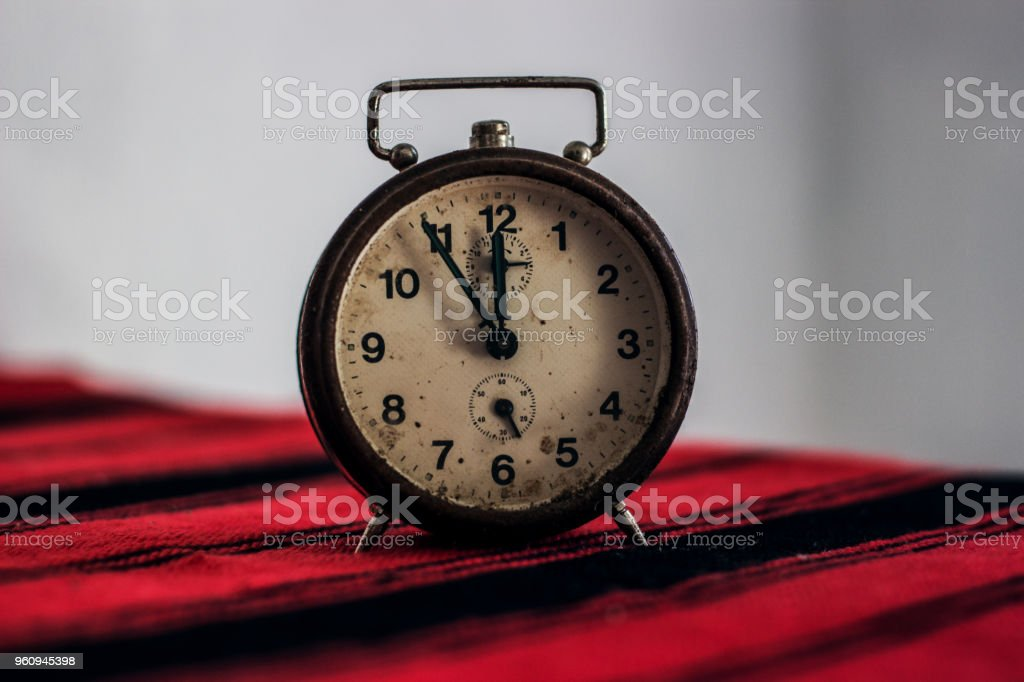 Old clock isolated on a table