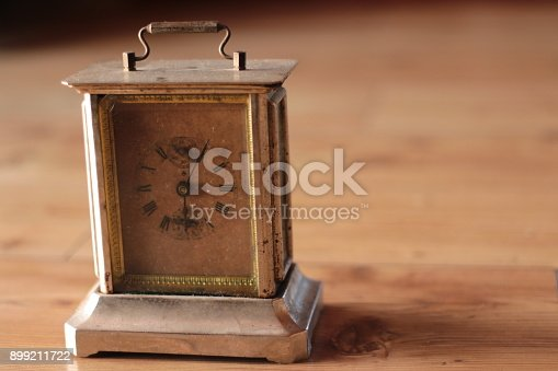 671883446istockphoto Old clock with gear mechanism 899211722