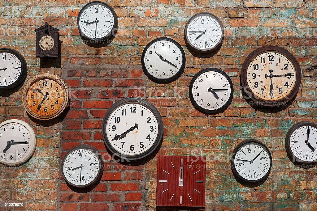 Old clocks  on brick wall stock photo