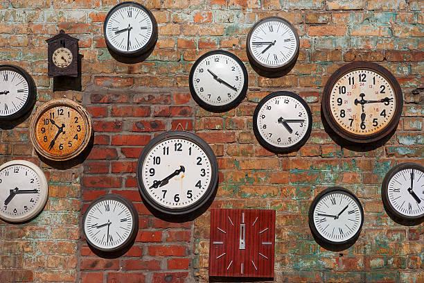 Old clocks  on brick wall stock photo