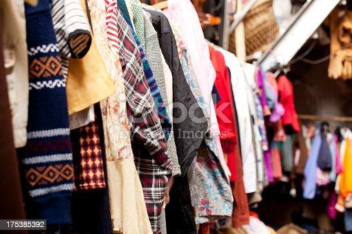 Old clothes a row in a flea market