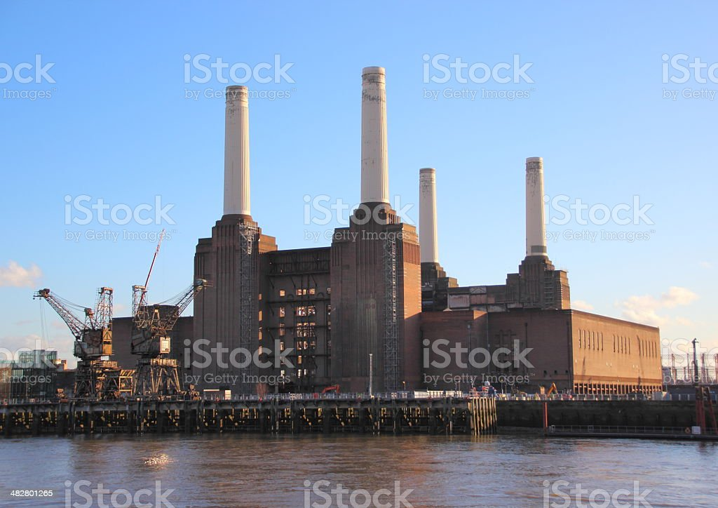 Old coal power plant with chimenys at waterfront stock photo