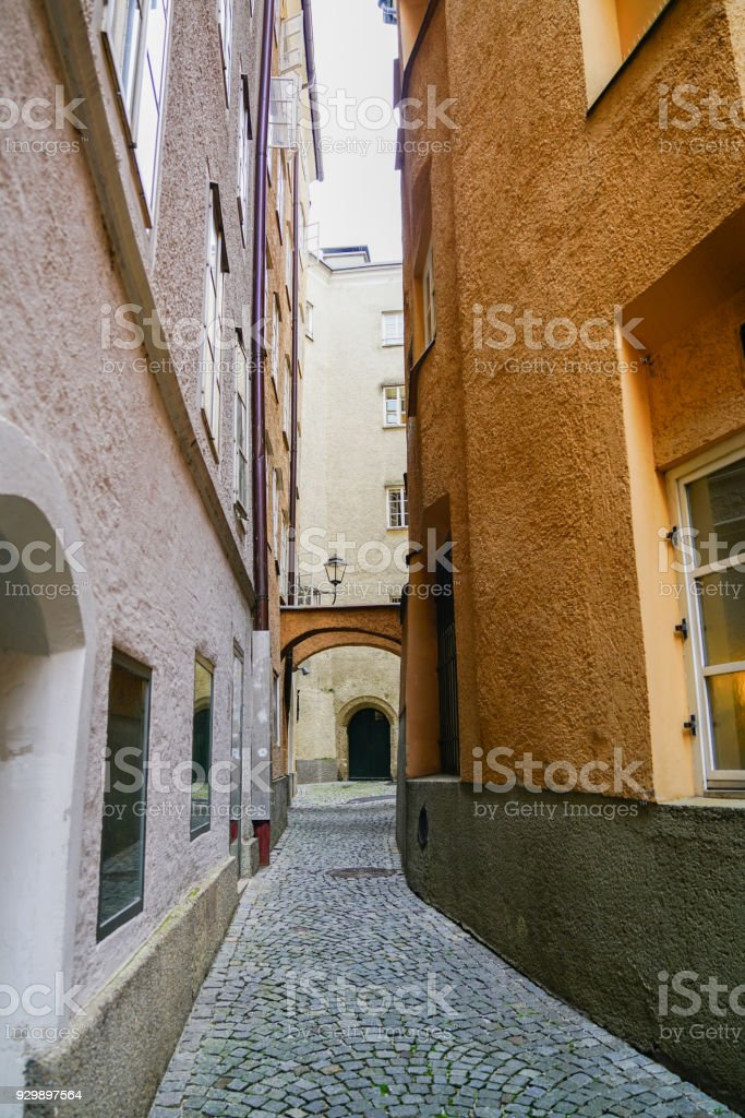 Old cobbled laneway between tall buildings stock photo