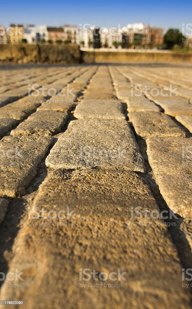 Old cobblestone road landscape in Seville royalty-free stock photo