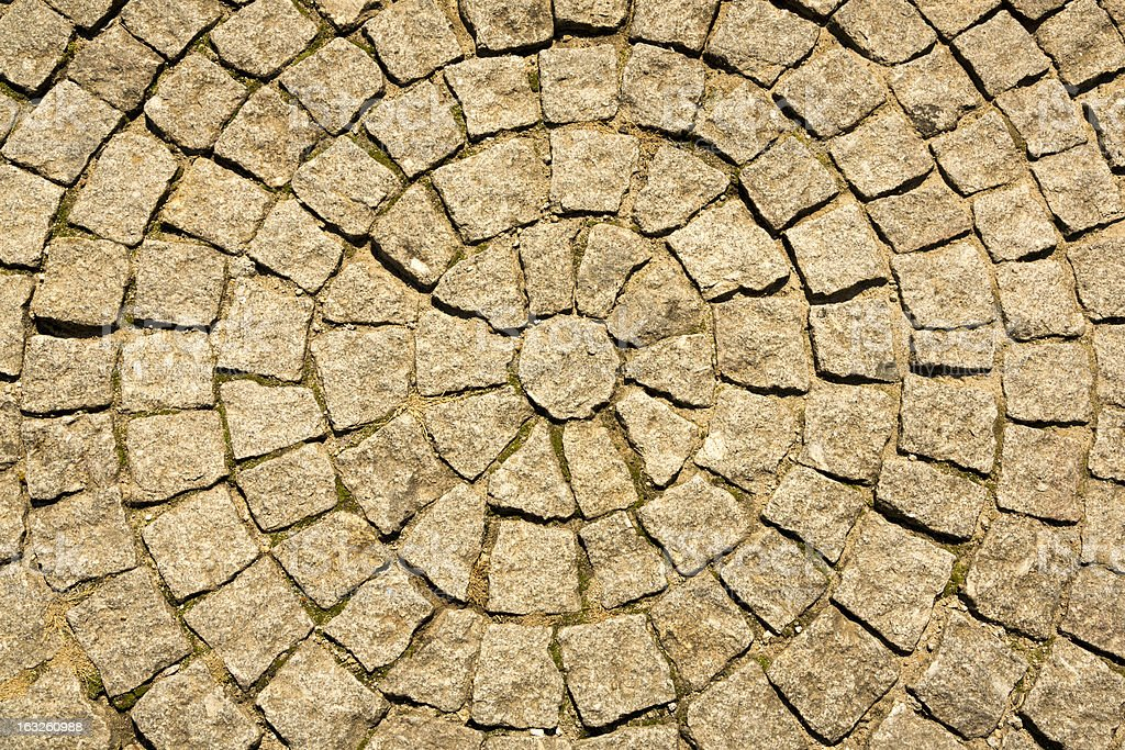 Old Cobblestone Road Surface Shaped in a circular pattern royalty-free stock photo