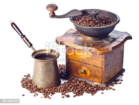 Old coffee grinder, coffee maker and roasted coffee beans isolated on white background
