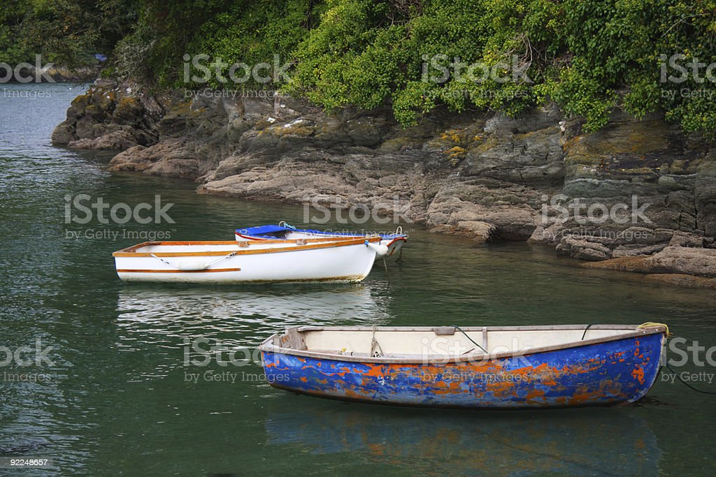 old cog fishing boats  on the sea white and blue royalty-free stock photo