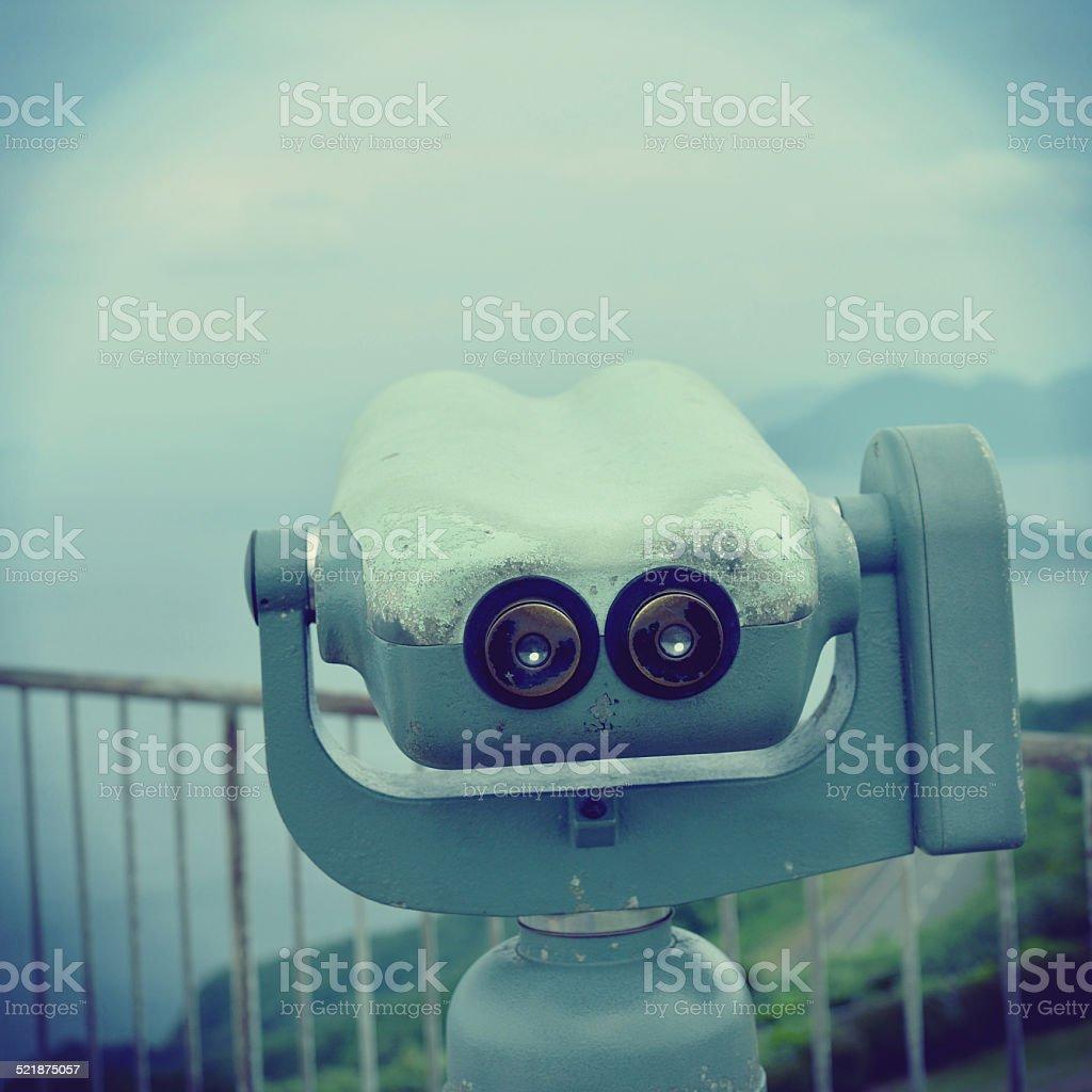 Old coin-operated binoculars stock photo