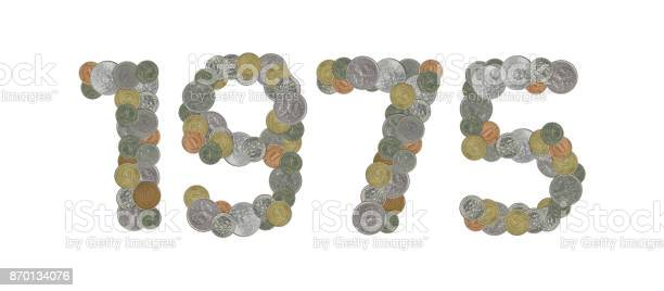 1975 – Old coins on white background