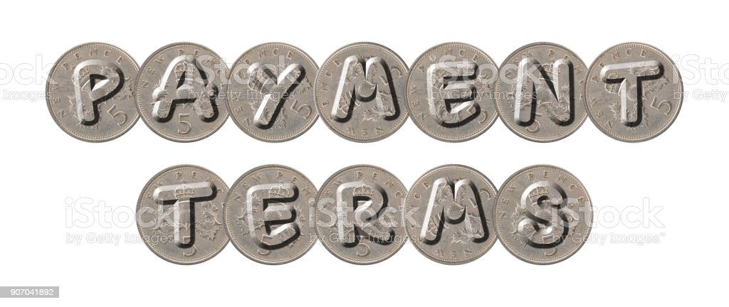 PAYMENT TERMS – Old coins on white background stock photo