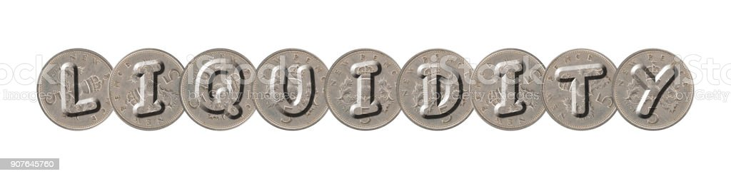 LIQUIDITY – Old coins on white background stock photo