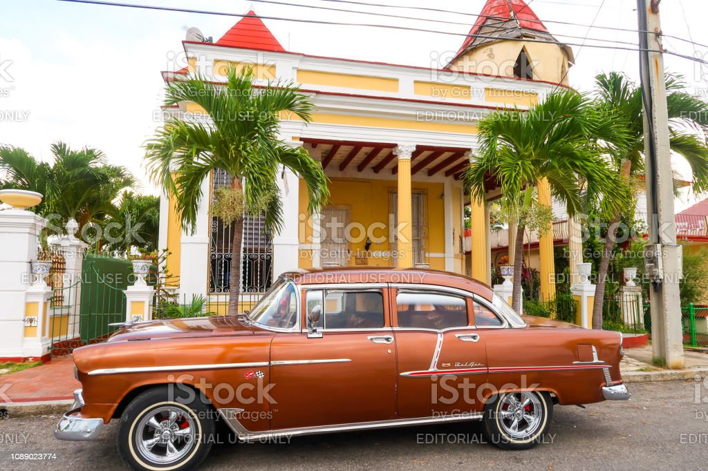Old Colonial House With Vintage Old Timer Car Parked in Front of the...