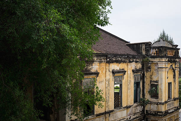 Old colonial A French colonial relic in Phnom Penh apostrophe stock pictures, royalty-free photos & images