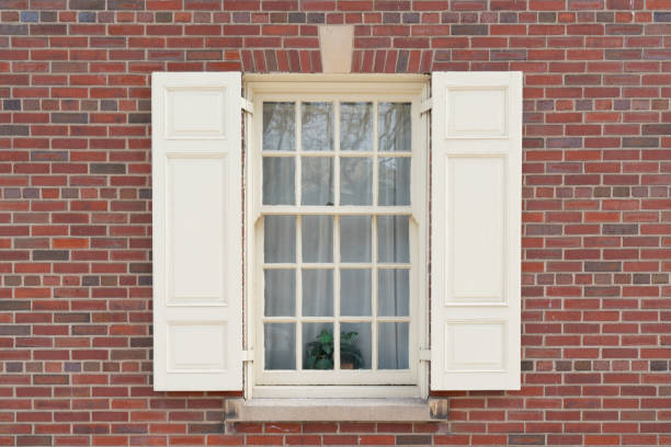 Old Colonial Window on Brick Building stock photo