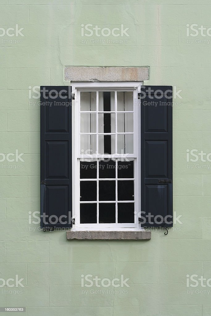 Old colonial window with shutters royalty-free stock photo