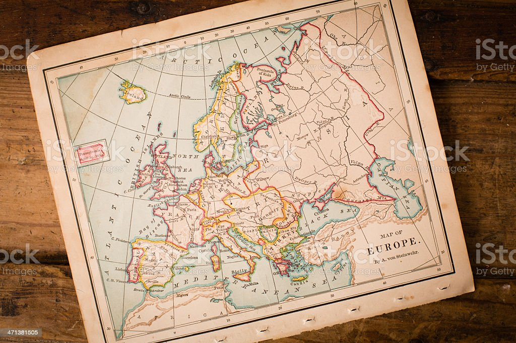 Old, Color Map of Europe, Sitting Angled on Wood Trunk stock photo