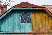 istock Old colored wooden loft with a small window 914997596