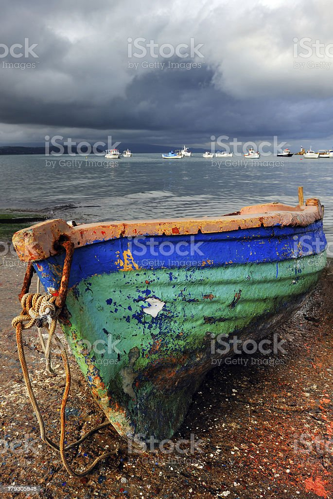 Old colorful fishing boat stock photo