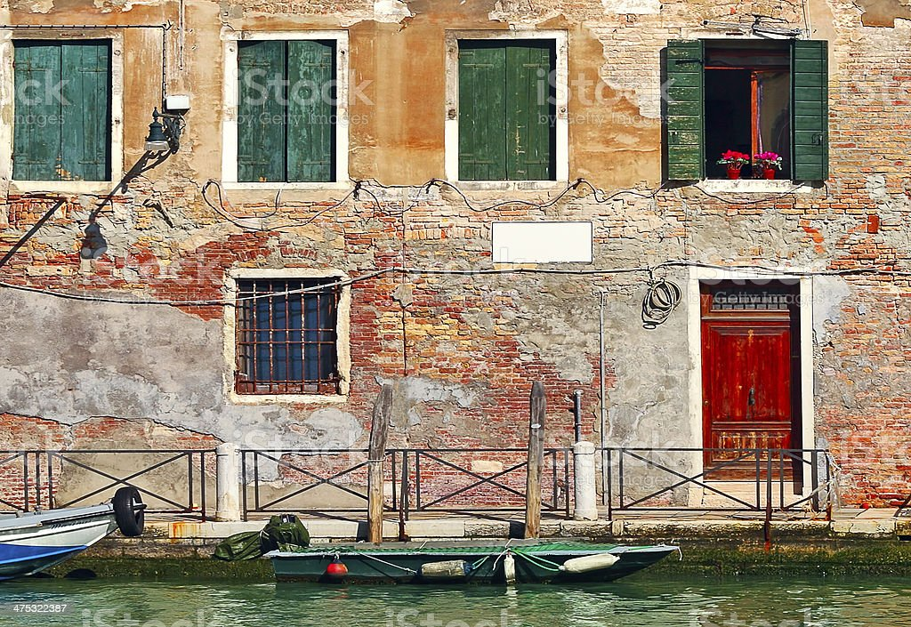 Old colorful house on narrow canal in Venice. royalty-free stock photo
