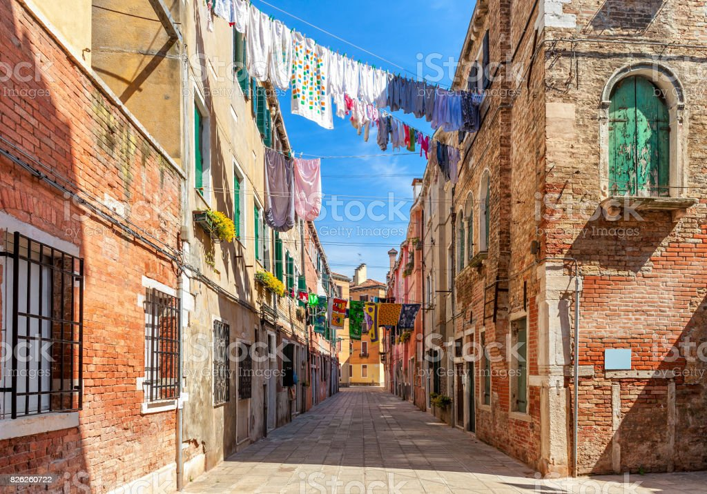 Old colorful houses and small street in venice. stock photo