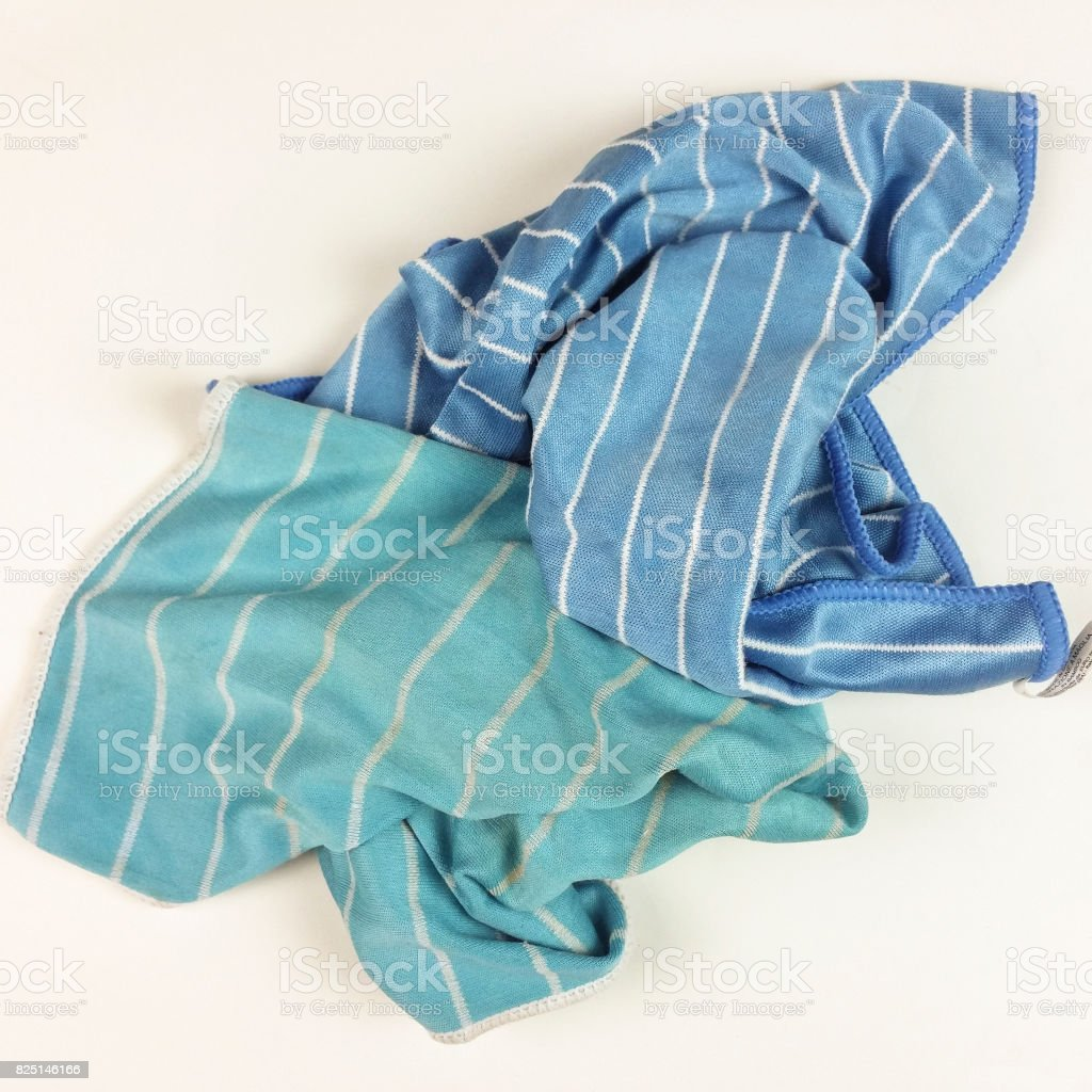old colorful rags on white background - top view stock photo