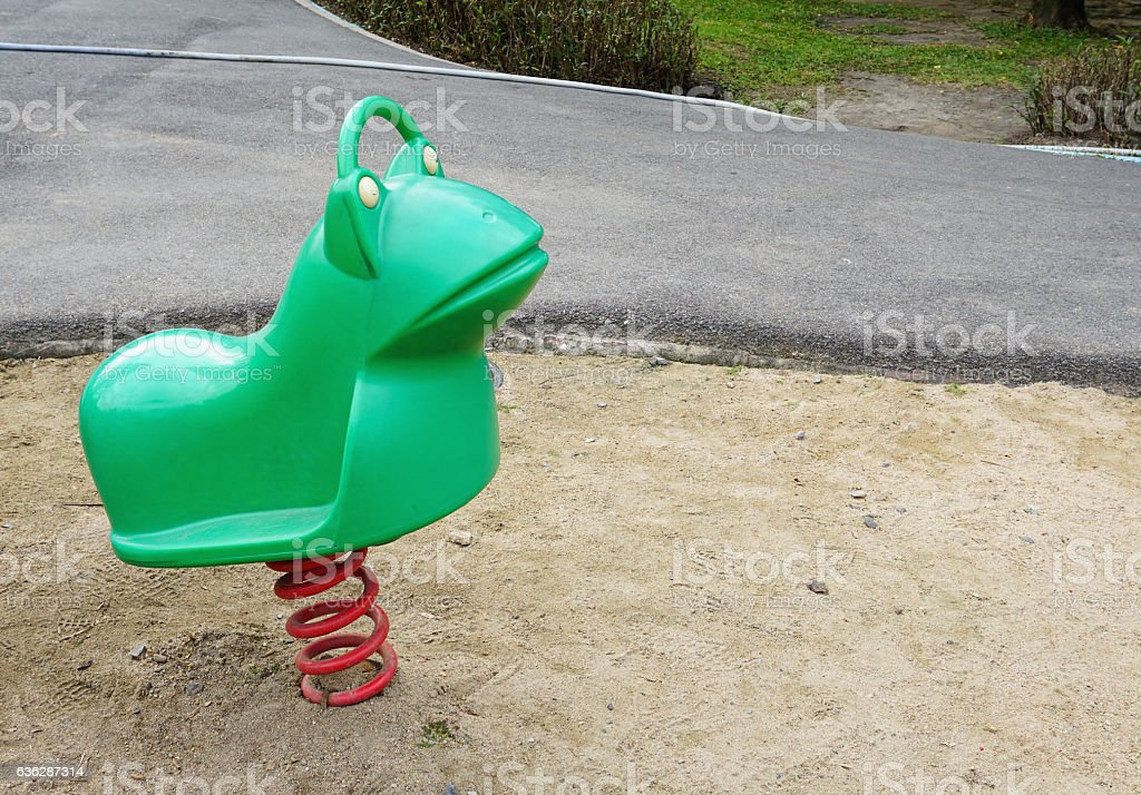Old colorful seesaw stock photo