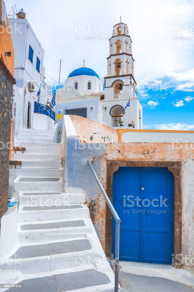 Old colorful wooden doors and bell tower at the traditional village of Pirgos, Santorini, Greece. foto stock royalty-free