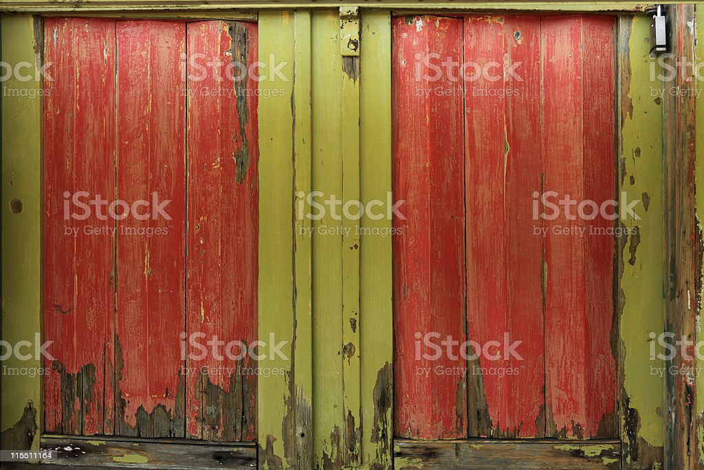 Old colorful wooden doors in red and yellow-green (XXXL) royalty-free stock photo