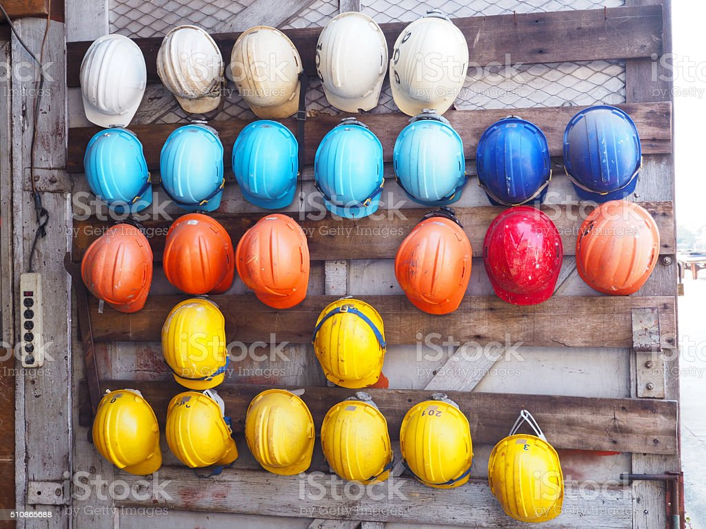 old colrful construction helmets stock photo