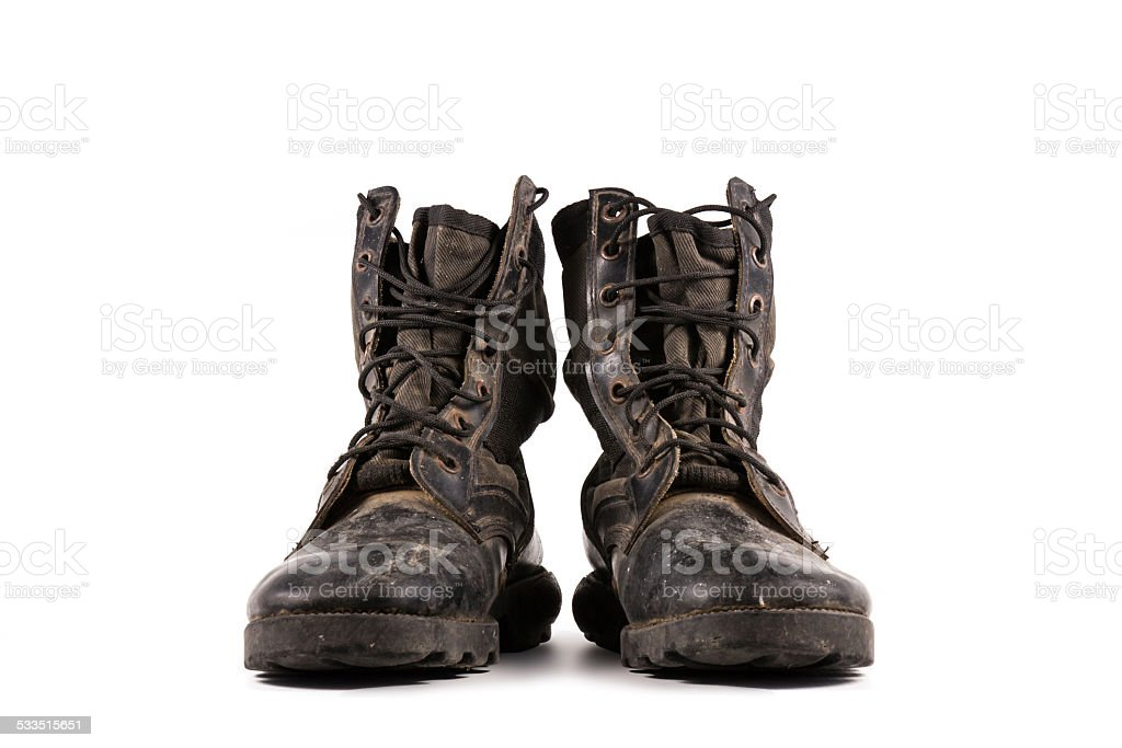 Old combat boots isolated on white. stock photo