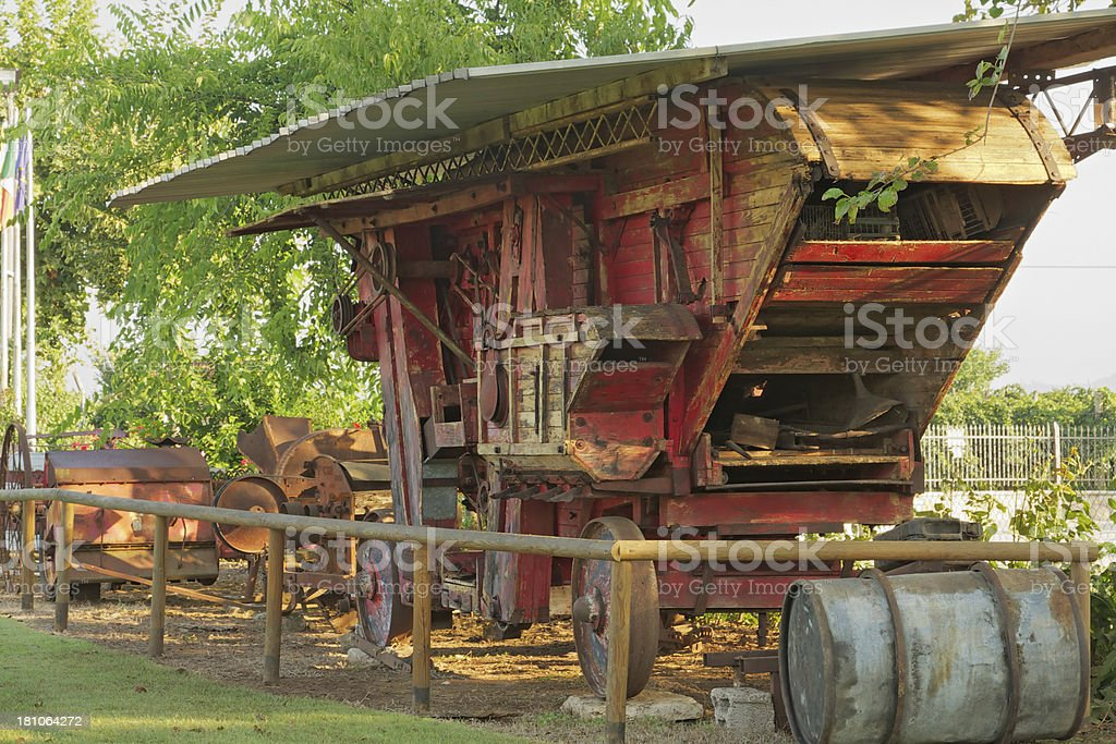 Old combine harvester in a farm. Italy. stock photo