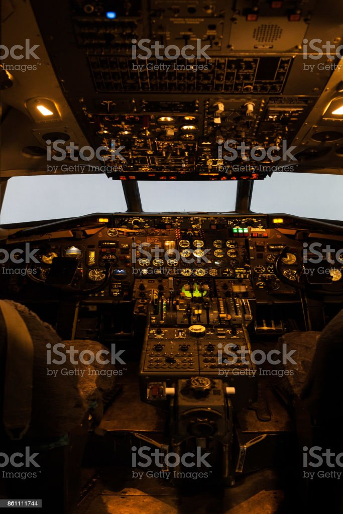 Old commercial aircraft cockpit stock photo