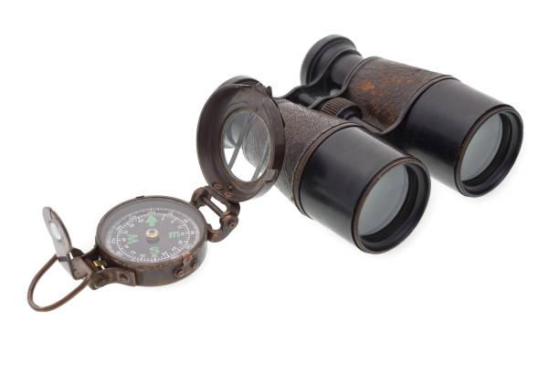 Old compass and binocular stock photo