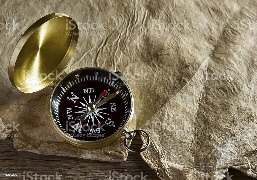 Old compass and paper royalty-free stock photo