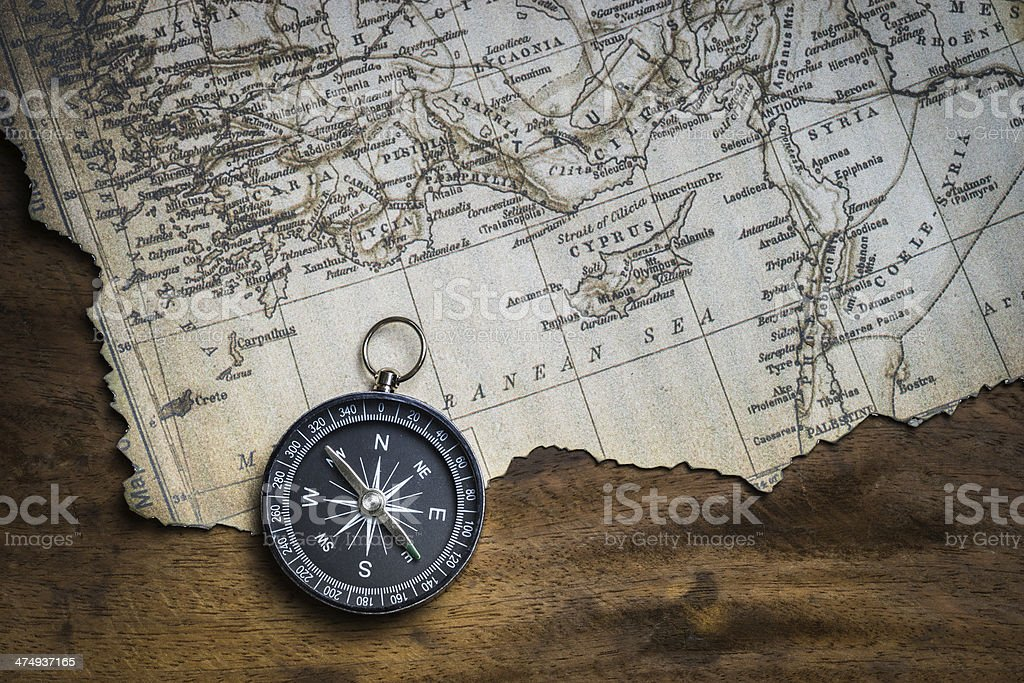 Old compass and vintage map stock photo