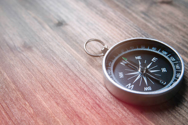 Old compass on a dark wooden background. Copy space for text or design Old compass on a dark wooden background. Copy space for text or design compass stock pictures, royalty-free photos & images