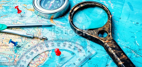 istock Old compass on vintage map 1140510715