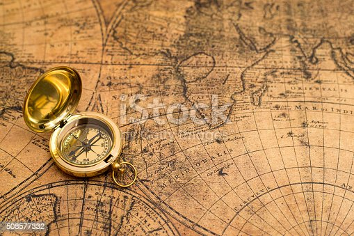 istock old compass  on vintage map 508577332