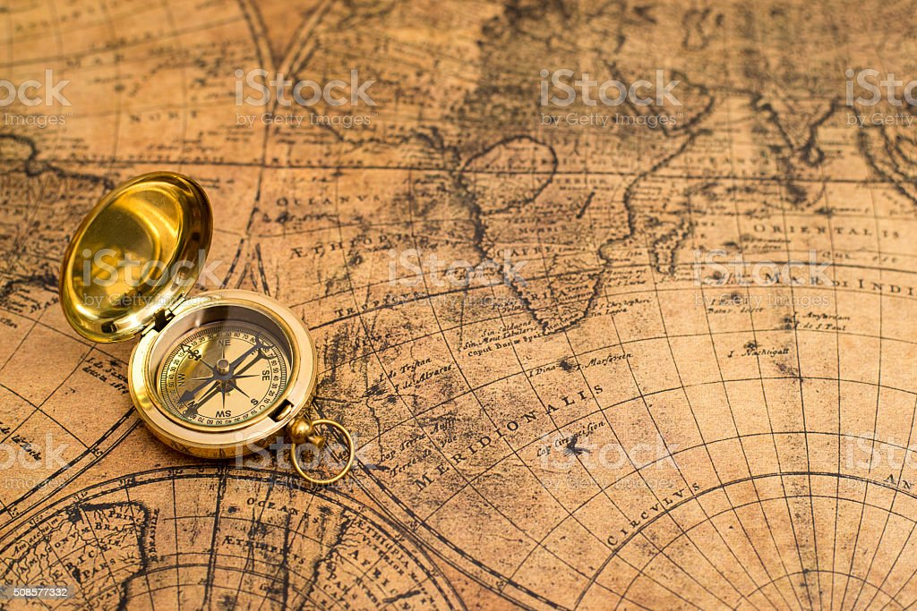 old compass  on vintage map stock photo