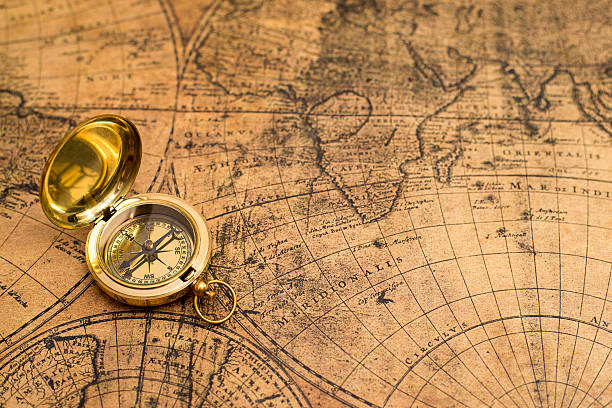 old compass  on vintage map - map oceans bildbanksfoton och bilder