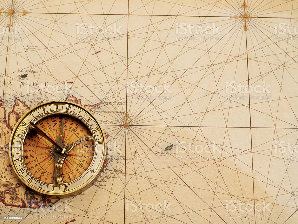 Old compass over ancient map stock photo