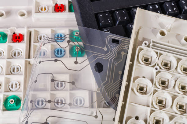 Old computer keyboards. Plastic waste sorting and disposal. Printed flex circuit membrane. Push buttons stock photo