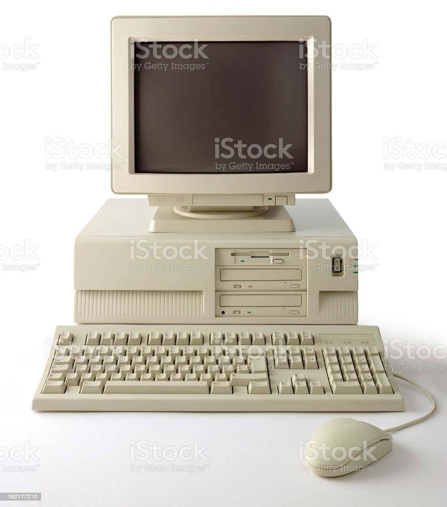 Old computer with monitor, keyboard and mouse on white background royalty-free stock photo