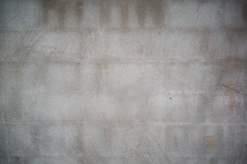 905087856 istock photo Old concrete block wall background texture 908875310