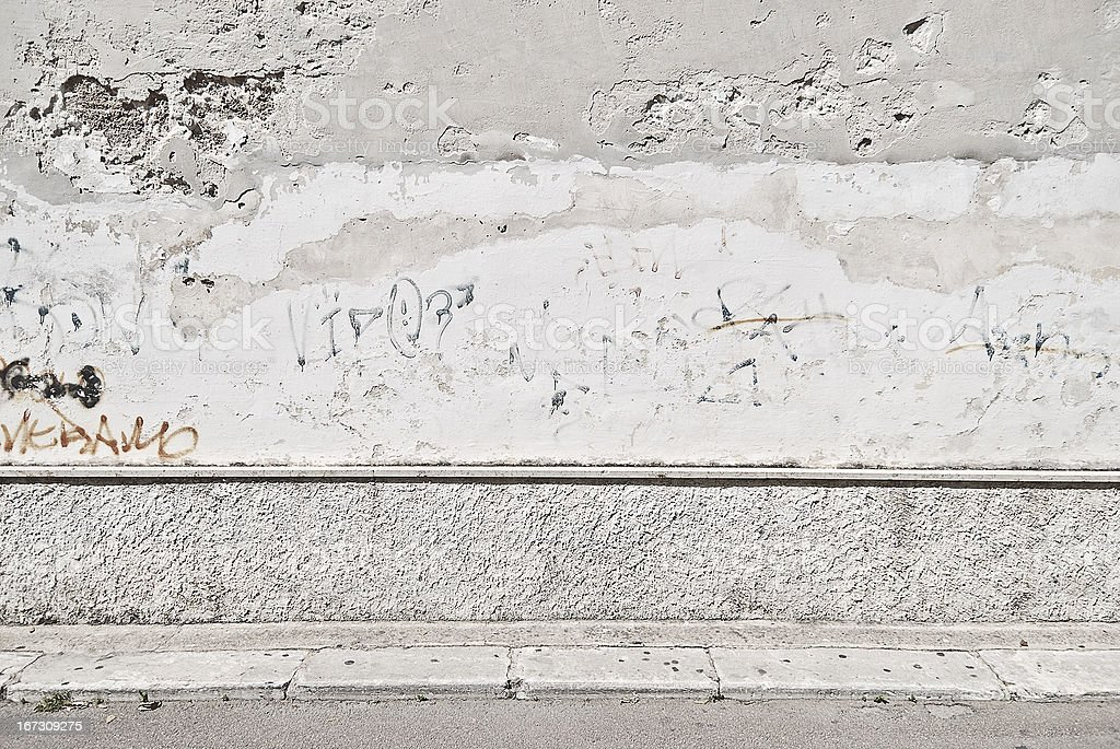 Old concrete grunge wall with sidewalk royalty-free stock photo