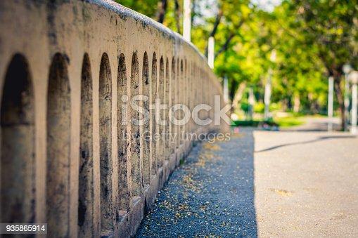 istock Old concrete river bridge railing, abstract 935865914