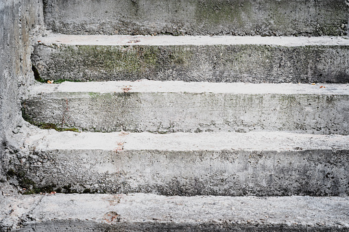 Front view of very old concrete stairs.